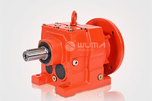 How does the helical gear reducer work